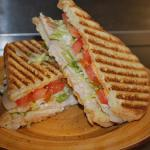 Buffalo Chicken Ranch Panini:  Grilled chicken breast & house made buffalo sauce grilled on veinna french bread with fresh lettuce, tomato, onion and ranch $6.59